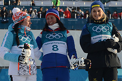 February 25, 2018 - Pyeongchang, South Korea - KRISTA PARMAKOSKI of Finland (left) , MARIT BJOERGEN of Norway (center) and STINA NILLSON of Sweden pose for a photograph after the Ladies' 30km Mass Start Classic cross-country ski racing event in the PyeongChang Olympic Games. (Credit Image: © Christopher Levy via ZUMA Wire)
