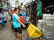 21 SEPTEMBER 2016 - BANGKOK, THAILAND: Workers drop off plastic baskets for produce and other things sold in the street market that has sprung up around the old Bang Chak Market. The market closed permanently on January 4, 2016. The Bang Chak Market served the community around Sois 91-97 on Sukhumvit Road in the Bangkok suburbs. Bangkok city authorities put up notices in late November 2015 that the market would be closed by January 1, 2016 and redevelopment would start shortly after that. Market vendors said condominiums are being built on the land.      PHOTO BY JACK KURTZ
