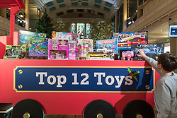 "© Licensed to London News Pictures. 14/11/2018. LONDON, UK. A boy examines the Top 12 Toys. Preview of ""DreamToys"", the official toys and games Christmas Preview, held at St Mary's church in Marylebone.  Recognised as the countdown to Christmas, the Toy Retailer's Association, an independent panel of leading UK toy retailers, have selected the definitive and most authoritative list of what toys will be the hottest property this Christmas. [Child models provided by show organisers, permission obtained to be photographed].  Photo credit: Stephen Chung/LNP"