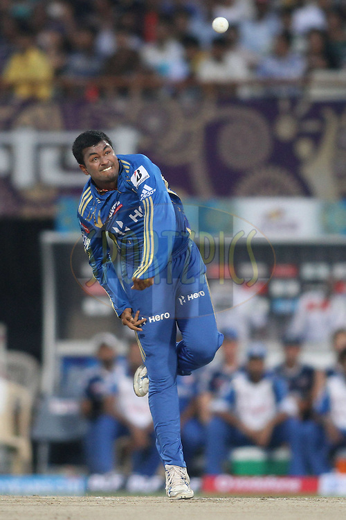 Pragyan Ojha of the Mumbai Indians sends down a delivery during match 58 of the the Indian Premier League (IPL) 2012  between The Kolkata Knight Riders and The Mumbai Indians held at the Eden Gardens Stadium in Kolkata on the 12th May 2012..Photo by Shaun Roy/IPL/SPORTZPICS