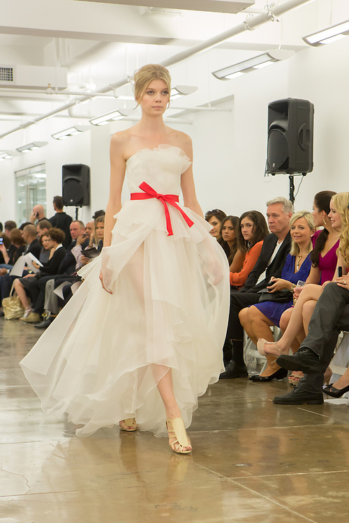 Strapless white gown in layers of organza. By Carmen Marc Valvo at the Spring 2013 Fashion Week show in New York.