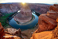 The sun sets directly into the center of the canyon and lights up this magical place.