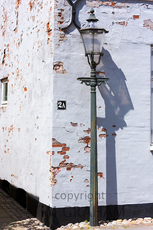 Old fashioned street lamp light in medieval street in Ribe centre, South Jutland, Denmark