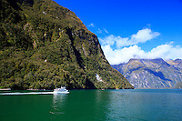 A cruise ship on the waters of Milford Sound in the South Island of New Zealand.