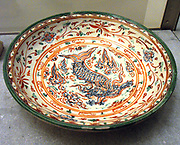 Vietnamese Grand circular plate, decorated with a Feiyu (dragon-fish), chrysanthemums. 16th century, Later The Dynasty (1428-1789) stoneware (ceramic), With decoration.