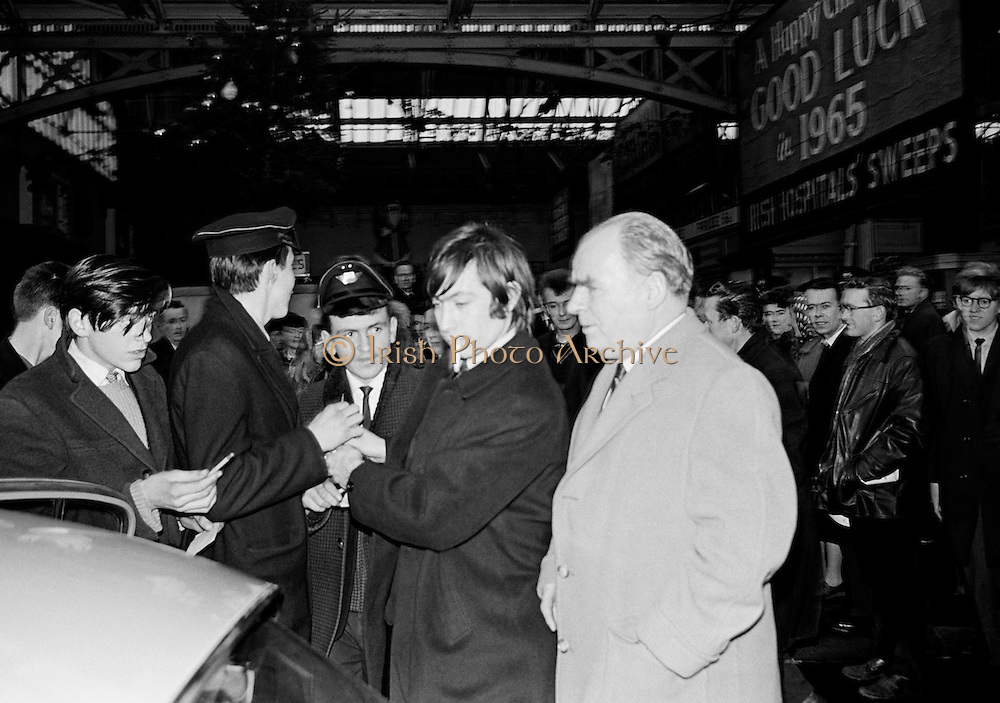 .The Rolling Stones Charlie is my Darling - Ireland 1965..Charlie Watts signs autographs for fans at Amiens Street station (now Connolly station) before The Rolling Stones  concert at the Adelphi Theatre. This was the band's first Irish tour of 1965...The Rolling Stones Charlie is my Darling - Ireland 1965.Out November 2nd from ABKCO.Super Deluxe Box Set/Blu-ray and DVD Details Revealed. .07/01/1965.01/07/1965.07 January 1965..ABKCO Films is proud to join in the celebration of the Rolling Stones 50th Anniversary by announcing exclusive details of the release of the legendary, but never before officially released film, The Rolling Stones Charlie is my Darling - Ireland 1965.  The film marked the cinematic debut of the band, and will be released in Super Deluxe Box Set, Blu-ray and DVD configurations on November 2nd (5th in UK & 6th in North America).. .The Rolling Stones Charlie is my Darling - Ireland 1965 was shot on a quick weekend tour of Ireland just weeks after ?(I Can't Get No) Satisfaction? hit # 1 on the charts and became the international anthem for an entire generation.  Charlie is my Darling is an intimate, behind-the-scenes diary of life on the road with the young Rolling Stones featuring the first professionally filmed concert performances of the band's long and storied touring career, documenting the early frenzy of their fans and the riots their live performances incited.. .Charlie is my Darling showcases dramatic concert footage - including electrifying performances of ?The Last Time,? ?Time Is On My Side? and the first ever concert performance of the Stones counterculture classic, ?(I Can't Get No) Satisfaction.?  Candid, off-the-cuff interviews are juxtaposed with revealing, comical scenes of the band goofing around with each other. It's also an insider's glimpse into the band's developing musical style by blending blues, R&B and rock-n-roll riffs, and the film captures the spark about to combust into The Greatest Rock and Roll Band in the World..