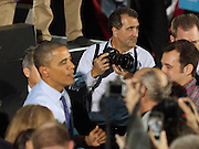 Pete Souza (Top), current Chief Official White House photographer for President Barack Obama, Director of the White House Photography Office and Assistant Professor at Ohio University's School of Visual Communication, photographs President Obama at a re- election rally on the Athens Campus of Ohio University on October 17, 2012.