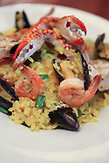 Seafood plate with mussels, shrimps and crab on rice