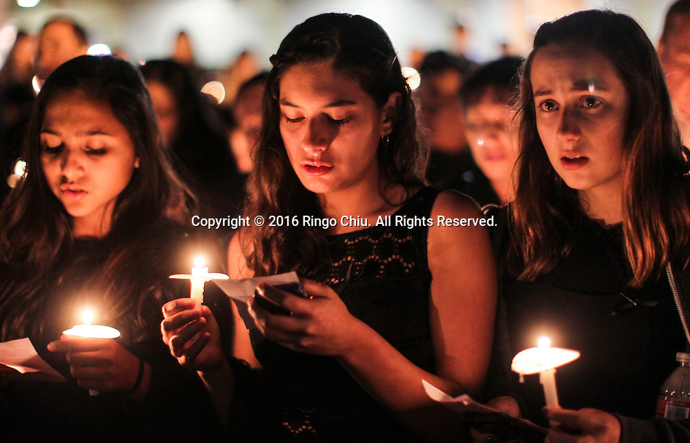 Students and parents attend a vigil for slain students Anthony Lin, 15, and William Lin, 16, at the Arcadia High School in Arcadia, California January 25, 2016. The brothers were allegedly beaten to death in their home by their uncle last Friday.(Photo by Ringo Chiu/PHOTOFORMULA.com)<br /> <br /> Usage Notes: This content is intended for editorial use only. For other uses, additional clearances may be required.