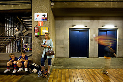 Barcelona,Spain. Football field of FC Barcelona. A woman with her two kids during de break.© Carmen Secanella.