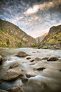 Idaho. Middle Fork Salmon River. Motion blur of water with Impassible Canyon at sunrise.