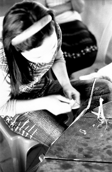 A landmine survivor attending a workshop on textiles in a school set up by a local NGO near the Cambodian Landmine Museum in Siem Reap's province, Cambodia.