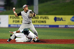 09 June 2011: Frank Martinez slides into second base and Zac Messer but Messer completes the tag and turns a double play during a game between the Lake Erie Crushers and the Normal Cornbelters at the Corn Crib in Normal Illinois.