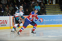 KELOWNA, CANADA, FEBRUARY 15: Michael St. Croix #18 of the Edmonton Oil Kings and Mackenzie Johnston #22 of the Kelowna Rockets skate on the ice at the Kelowna Rockets on February 15, 2012 at Prospera Place in Kelowna, British Columbia, Canada (Photo by Marissa Baecker/Shoot the Breeze) *** Local Caption ***