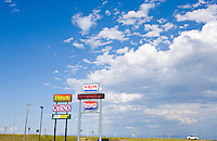 Service station signs and sky along Interstate Highway 90 in Southwestern Montana.