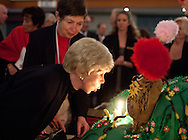 Audrey Geisel blows out the birthday candles on a cake fashioned after the Dr. Suess book The Lorax, while Chancellor Maryanne Fox looks on during the celebration for the late author Theodore Geisel's 107th birthday, March 3, 2011.