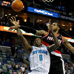 January 16, 2012; New Orleans, LA, USA; Portland Trail Blazers power forward LaMarcus Aldridge (12) fouls New Orleans Hornets small forward Al-Farouq Aminu (0) during the first quarter of a game at the New Orleans Arena.   Mandatory Credit: Derick E. Hingle-US PRESSWIRE