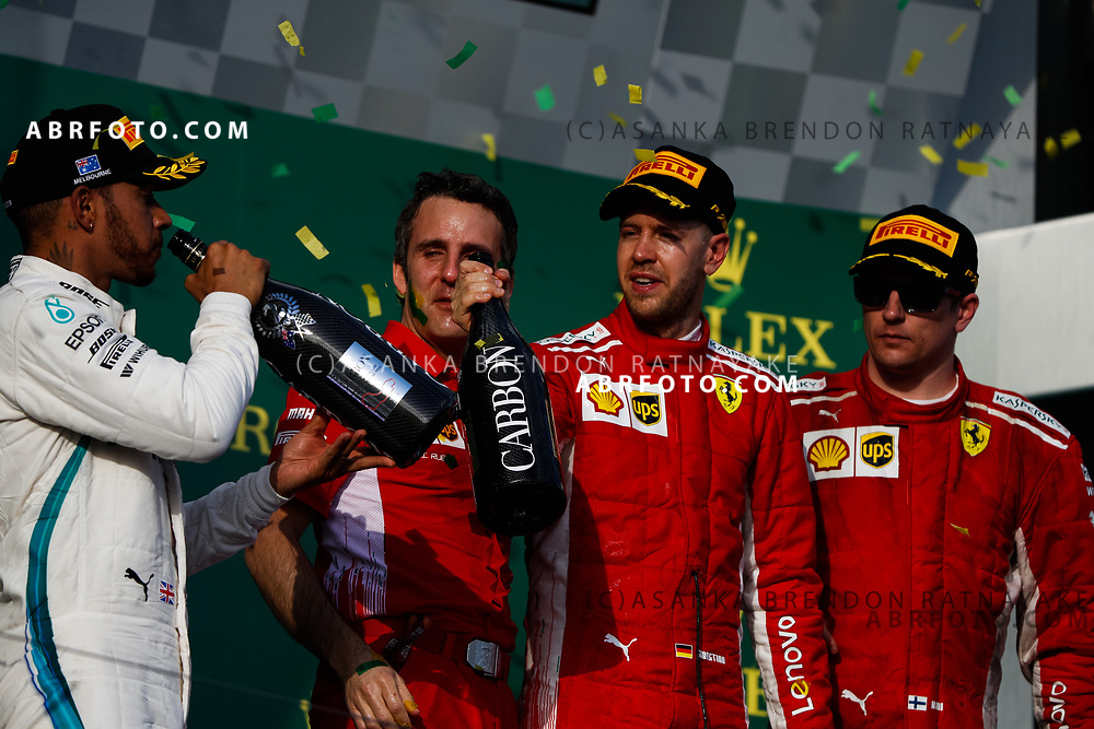 Mercedes driver Lewis Hamilton of Britain, Inaki Rueda, Ferrari Race Strategist, Ferrari driver Sebastian Vettel of Germany and Ferrari driver Kimi Raikkonen of Finland on the podium during the trophy presentation at the end of the 2018 Rolex Formula 1 Australian Grand Prix at Albert Park, Melbourne, Australia, March 24, 2018.  Asanka Brendon Ratnayake