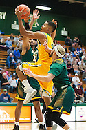 Vermont's Trae Bell-Hayens (2) leaps for a lay up during the men's basketball game between the Lyndon State Hornets and the Vermont Catamounts at Patrick Gym on Saturday afternoon November 19, 2016 in Burlington (BRIAN JENKINS/for the FREE PRESS)