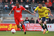Leyton Orient striker Jay Simpson gets the better of Oxford midfielder Liam Sercombe during the Sky Bet League 2 match between Leyton Orient and Oxford United at the Matchroom Stadium, London, England on 17 October 2015. Photo by Bennett Dean.