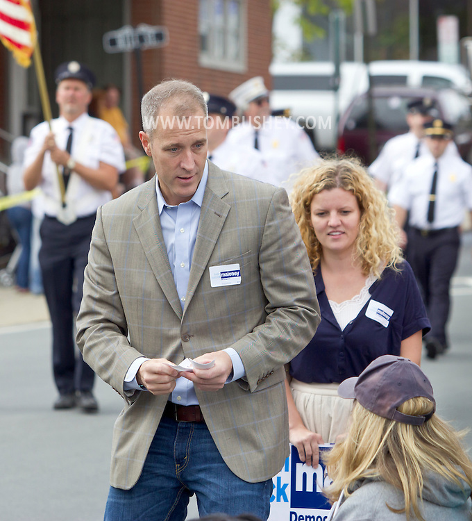Middletown, New York - Democratic candidate Sean Patrick Maloney, who is running for Congress in the 18th Congressional District, talks to people watching the Middletown Fire Department's annual Inspection Parade on Oct. 6, 2012. Maloney is a former adviser to President Bill Clinton.