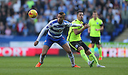 Reading defender Michael Hector (8) shields the ball during the Sky Bet Championship match between Reading and Brighton and Hove Albion at the Madejski Stadium, Reading, England on 31 October 2015.