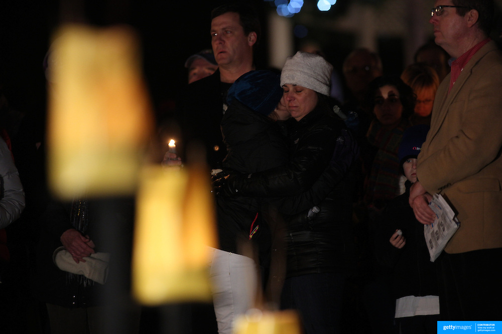 Locals mourn at a townwide community vigil on Sherman Green. Fairfield, Connecticut after the mass shootings at Sandy Hook Elementary School, Newtown, Connecticut, USA. 17th December 2012. Photo Tim Clayton
