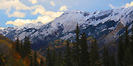 Beautiful autumn colors with the snow capped peaks of Red Mountain Pass the San Juan Mountains, a sub range of the Colorado Rocky Mountains along the Million Dollar Highway.