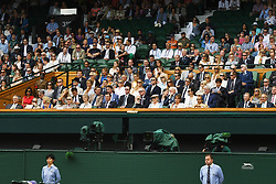 © Licensed to London News Pictures. 12/07/2019. London, UK. Guests including Rebecca Bana, Eric Bana, Hugh Grant, Jude Law and  Michael McIntyre watch centre court tennis in the royal box on Day 11 of the Wimbledon Tennis Championships 2019 held at the All England Lawn Tennis and Croquet Club. Photo credit: Ray Tang/LNP