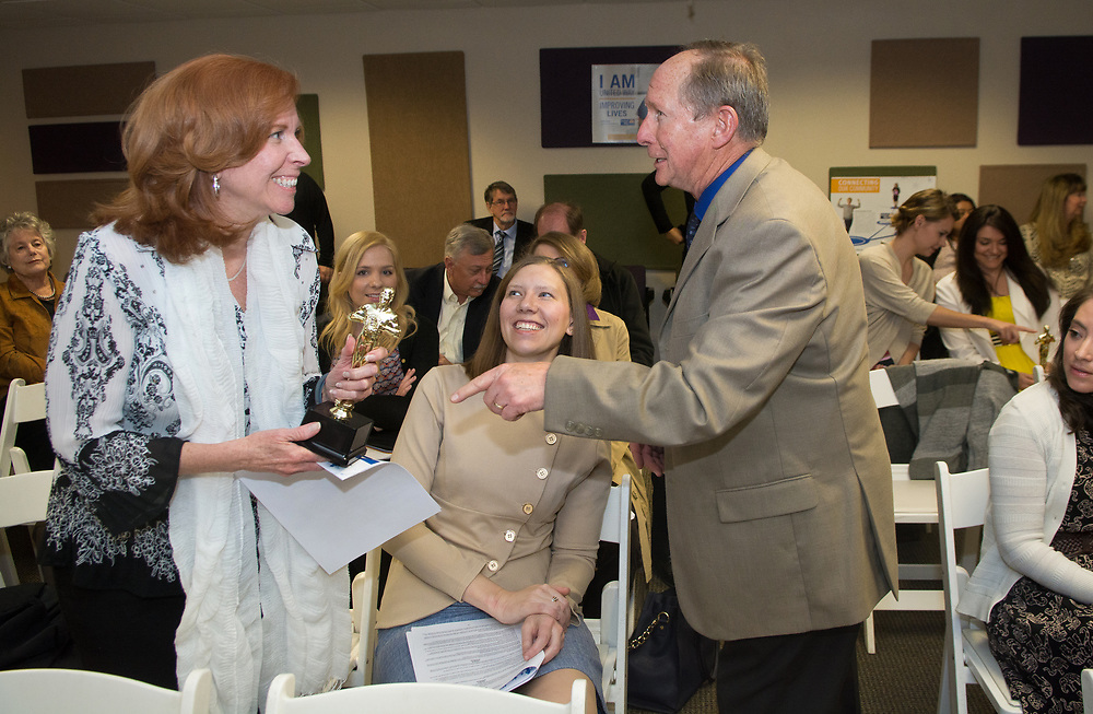 mkb031117d/metro/Marla Brose<br /> United Way's Paul Vuchetich, right, hands Shirley Anderson of Klinger Constructors an award for her work with the United Way of Central New Mexico's campaign during the annual meeting and Albuquerque, N.M., March 14, 2017. Anderson was one of a group of people who received the award. (Marla Brose/Albuquerque Journal)