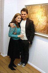 Artist JONATHAN YEO and SHEBAH RONAY at an exhibition of artist Jonathan Yeo's portrait paintings held at Eleven, 11 Eccleston Street, London SW1 on 16th February 2006.<br />