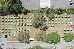 March 28, 2020, Tampa, Florida, USA: The city of Tampa along with Catholic Charities have set up an area that would house 100 homeless residents of Hillsborough County complete with a bed, food, toiletries and laundry facilities. (Credit Image: © Luis Santana/Tampa Bay Times via ZUMA Wire)