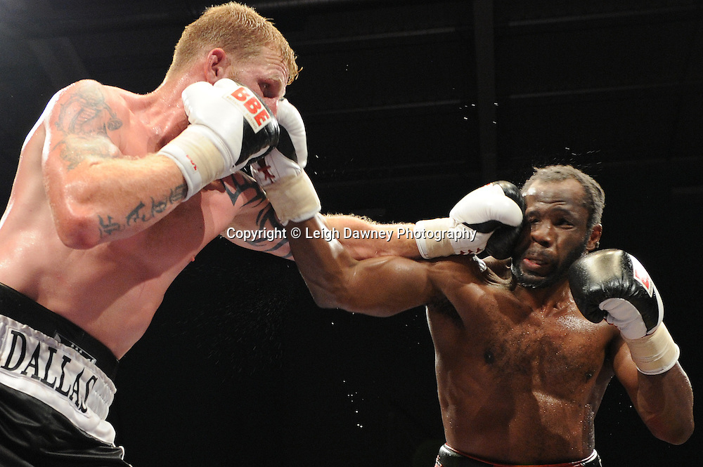 Tom Dallas (black shorts) defeats Zack Page in the Heavyweight contest at Medway Park, Gillingham, Kent,  UK on 13th May 2011. Frank Maloney Promotions. Photo credit © Leigh Dawney.