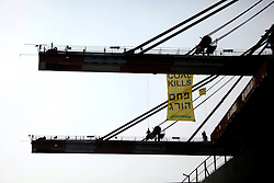 ISRAEL HADERA 15JUL10 - Greenpeace activists occupy the huge cranes at Hadera port to stop them from unloading a coal shipment. This action comes a few days after three Greenpeace activists boarded a coal ship heading for Israel and are part of an ongoing campaign to stop the construction of a new coal-fired power plant in Ashkelon, Israel...jre/Photo by Jiri Rezac / Greenpeace