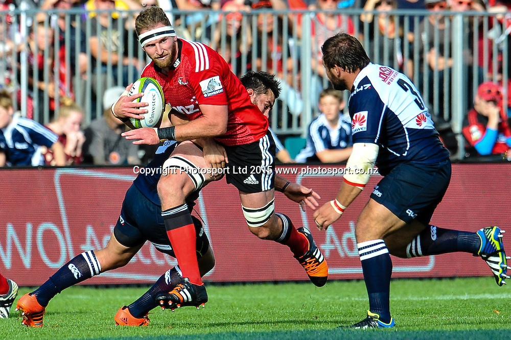 Kieran Read of the Crusaders is tackled by Robbie Coetzee  and Julian Redelinghuys of the Lions during the Super Rugby match: Crusaders v Lions at AMI Stadium, Christchurch, New Zealand, 14 March 2015. Copyright Photo: John Davidson / www.Photosport.co.nz