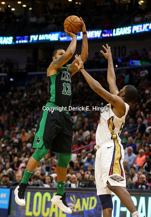 Mar 18, 2018; New Orleans, LA, USA; Boston Celtics forward Marcus Morris (13) shoots over New Orleans Pelicans forward E'Twaun Moore (55) during the second half at the Smoothie King Center. Mandatory Credit: Derick E. Hingle-USA TODAY Sports