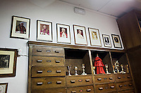 ROME, ITALY - 12 MARCH 2013: (L-R) Portraits of the last 7 popes dressed by the Gammarellis (Benedict XVI, John Paul II, John Paul I, Paul VI, John XXIII, Pius XII and Pius XI), are hanged on a wall at the entrance of the Gammarelli tailor shop, a family owned business since 1798 working for the Roman clergy, that has dressed popes for generations, in Rome, Italy, on March 12, 2013...On March 12, 2013, the 115 cardinals are set to enter the conclave to elect a successor to Pope Benedict XVI after he became the first pope in 600 years to resign from the role. The conclave will take place inside the Sistine Chapel and will be attended by 115 cardinals as they vote to select the 266th Pope of the Catholic Church.