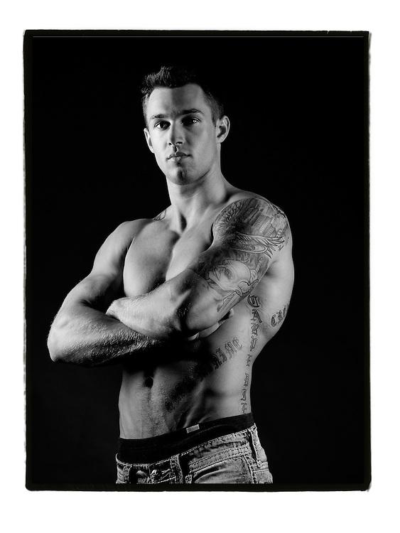 Athletic young man studio portrait