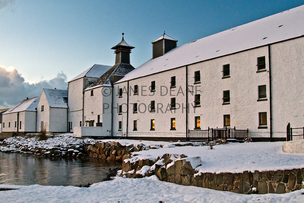 The Maltbarns at Laphroaig Distillery. A fiery sunset out West is reflected in the Visitor Centre (Ground Floor) windows