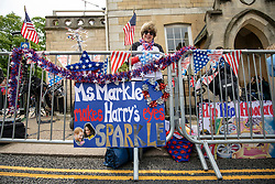 © Licensed to London News Pictures. 16/05/2018. Windsor, UK. Donna Werner, who has travelled from Connecticut in the USA for the Royal Wedding, stands with the banners she made with her daughter opposite Windsor Castle. Prince Harry and Meghan Markle are to be married on Saturday in Windsor. Photo credit: Rob Pinney/LNP