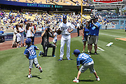 LOS ANGELES, CA - JUNE 15:  Andre Ethier #16 of the Los Angeles Dodgers plays catch with his children during Father's Day pregame festivities before the game against the Arizona Diamondbacks at Dodger Stadium on Sunday, June 15, 2014 in Los Angeles, California. The Diamondbacks won the game 6-3. (Photo by Paul Spinelli/MLB Photos via Getty Images) *** Local Caption *** Andre Ethier