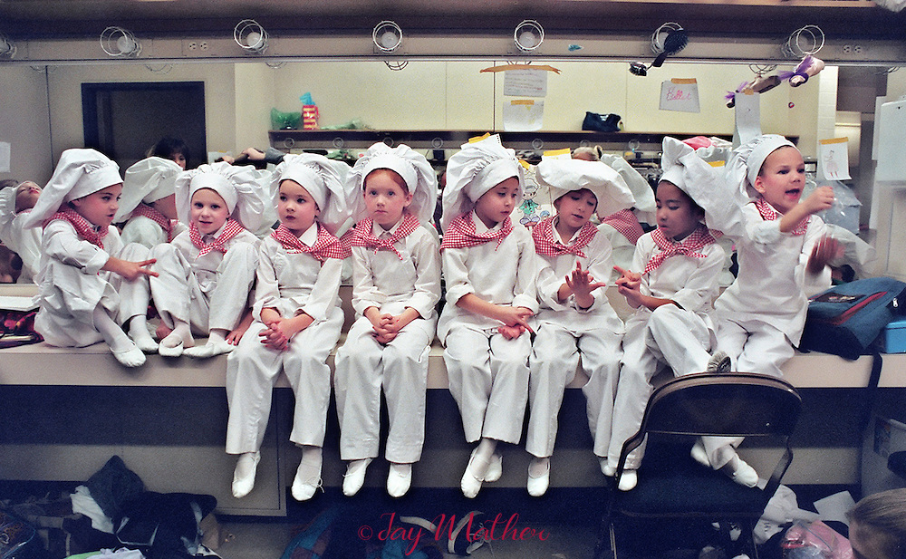 Boys costumed as cooks await their moment on stage for the Nutcracker performance by the Sacramento Ballet company.  Over 1,000 children participate in auditions during September and 436 are selected for the two-week run of the annual Christmas program at the Community Center theatre. .