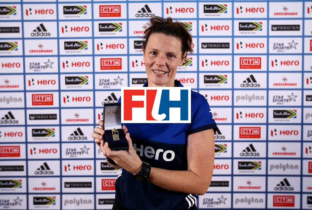 JOHANNESBURG, SOUTH AFRICA - JULY 10:  Umpire Kelly Hudson of New Zealand poses with her milestone award for officiating in 100 games during day 2 of the FIH Hockey World League Women's Semi Final at Wits University on July 10, 2017 in Johannesburg, South Africa.  (Photo by Jan Kruger/Getty Images for FIH)