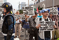 May 26, 2019, Tokyo Japan: A group of approximately 500 demonstrators who oppose the Japanese monarchy demonstrated today against President Trump's upcoming meeting with Emperor Naruhito. Due to the presence of ultra right-wingers who harass all demos that negatively portray Japan's Imperial system, a high number of riot police were on hand to separate the two groups. This took place in the vicinity of Shinjuku Station with the police far outnumbering the protestors. Trump who is currently in Tokyo on an official four day state visit will attend a banquet on Monday 5/27 hosted by the Emperor Naruhito. He will be the first world leader to meet with the new emperor who ascended the Chrysanthemum Throne on May 1. Photo by Torin Boyd.