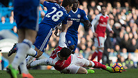 Football - 2016 / 2017 Premier League - Chelsea vs. Arsenal <br /> <br /> Olivier Giroud of Arsenal tries to keep possession after he slips on the grass at Stamford Bridge.<br /> <br /> COLORSPORT/DANIEL BEARHAM