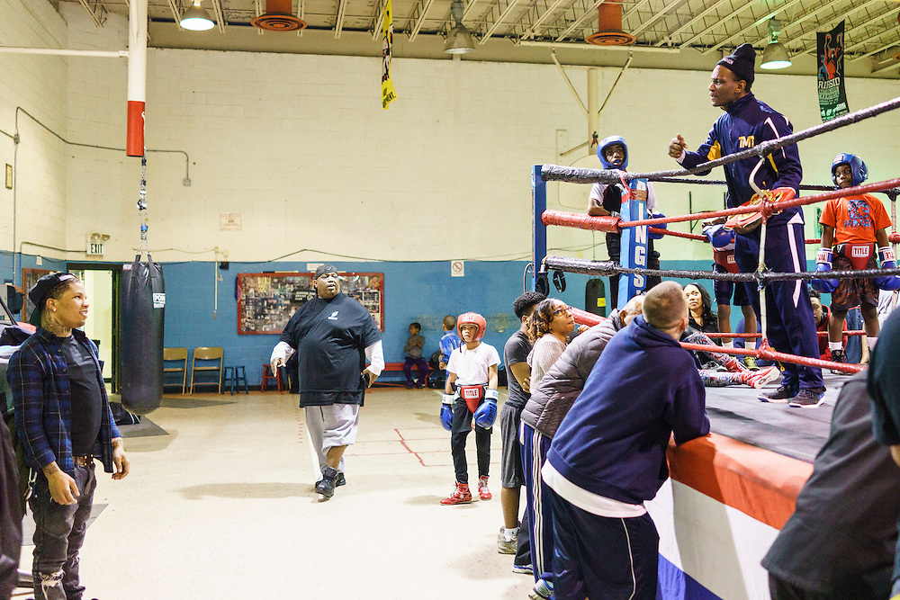 Baltimore, Maryland - January 26, 2017: Gervonta Davis declines his coach Calvin Ford's invitation to come up to center ring and show off his IBF Junior Lightweight championship belt at the Upton Boxing Club in Baltimore, Thursday January 26, 2017.<br /> <br /> <br /> CREDIT: Matt Roth for The New York Times<br /> Assignment ID: