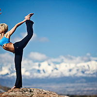 Woman performs Natarajasana yoga position in Big Cottonwood Canyon, Utah