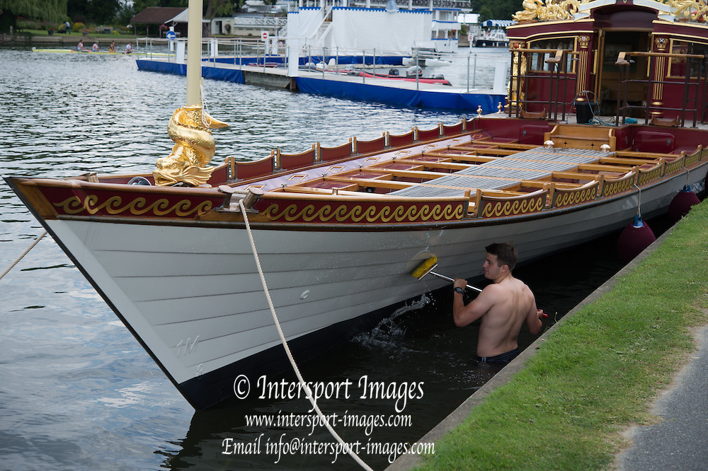 "Henley. Great Britain. Cleaning the Hull of the Gloriana at the 175th  Henley Royal Regatta, Henley Reach. England.The decorated, national oars/sculls, of ""The Peoples Republic of China"" . CHN 12:33:43  Tuesday  01/07/2014. [Mandatory Credit; Peter Spurrier/Intersport-images]"