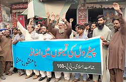 November 1, 2018 - Pakistan - LAHORE, PAKISTAN, NOV 01: Activists of Jamat-e-Islami (JI) are holding protest .demonstration against petroleum price hiking, at Wahdat road in Lahore on Thursday, November .01, 2018. (Credit Image: © PPI via ZUMA Wire)