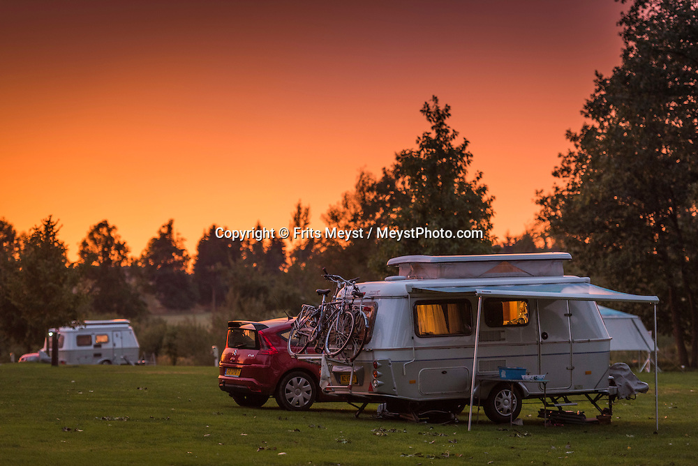 Opatov, Moravia, Czech Republic, September 2015. When the evening falls, camping guests make a fire and barbeque meat under the stars. Camping Vidlak in Opatov is owned by Dutch Jur and Lilian Vinke. Southern Moravia is most famous for its wine,  rolling hills and pretty landscapes. Photo by Frits Meyst / MeystPhoto.com